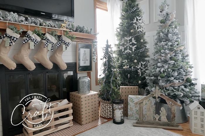 Neutral farmhouse Christmas living room - with blue, green, plaid, wood, and burlap Christmas Decorations
