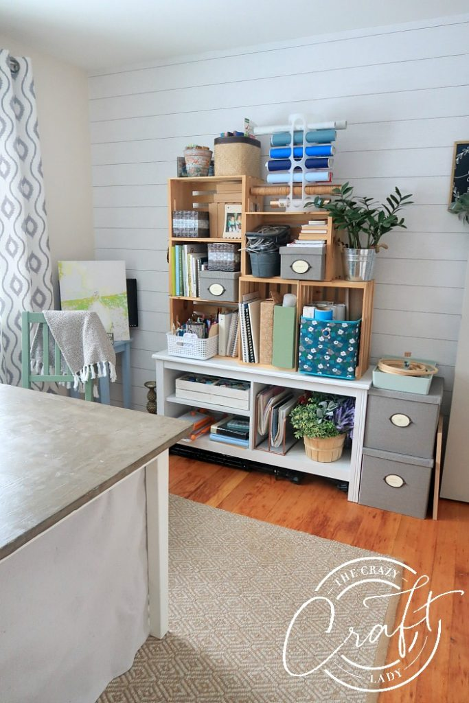 craft room tour from The Crazy Craft Lady - DIY wood crate shelves and a DIY concrete top craft table