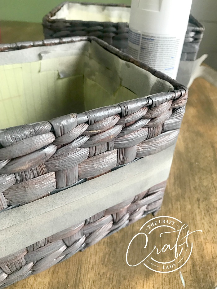 how to spray paint a wicker basket - tape off a straight line