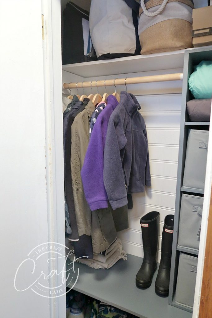 DIY entry closet shelves and cube storage to maximize space in a small front entry closet