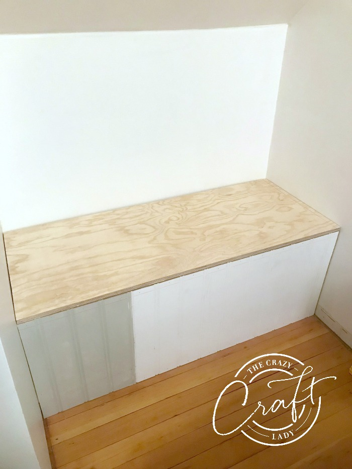 DIY built-in storage bench tutorial - using 2x4s and plywood