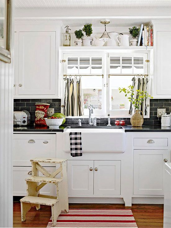 Decorating above kitchen cabinets with favorite collection of items from BHG