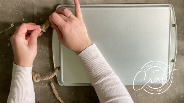adding nautical rope handles to a cookie sheet serving tray