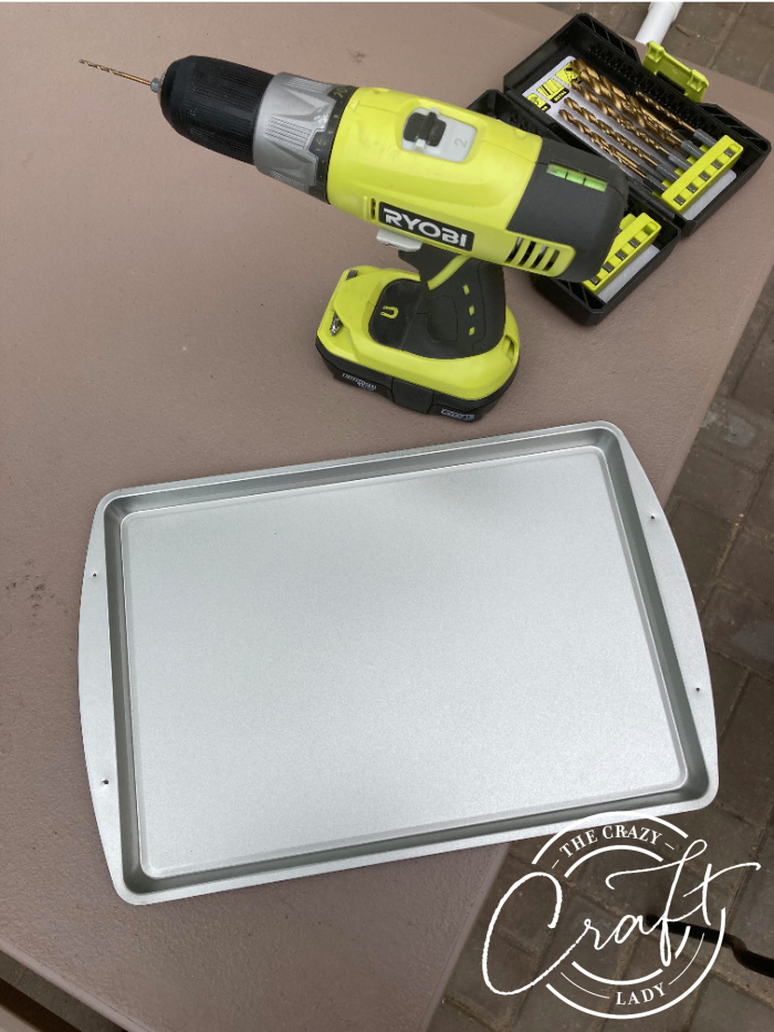 drilling holes in a cookie sheet for serving tray handles